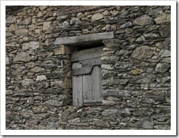 An old window in a stone wall
